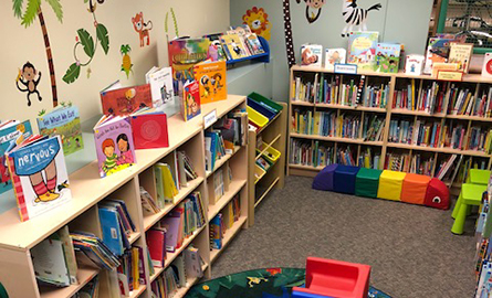 Kids corner with books and mats at the library