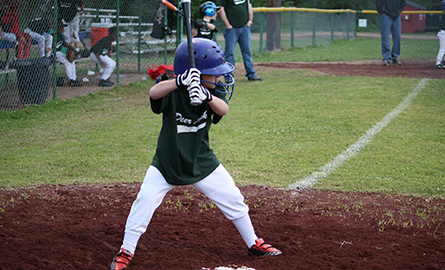 Boy playing baseball ready to hit to ball